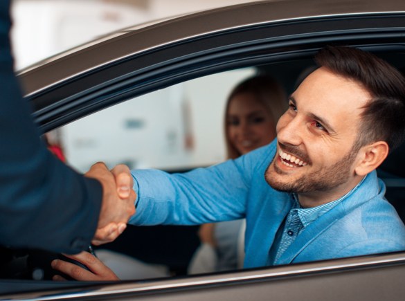 shaking hand after new car finance deal