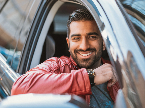 man in new car