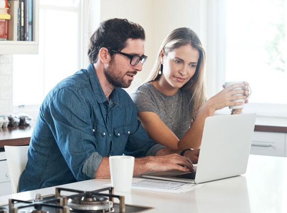 checking eligibility on laptop