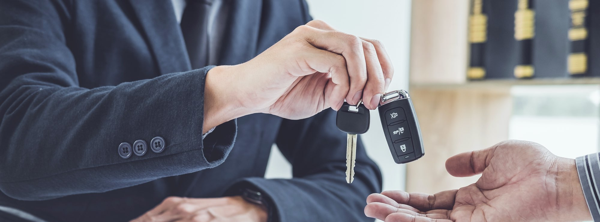 Handing over car keys to new owner