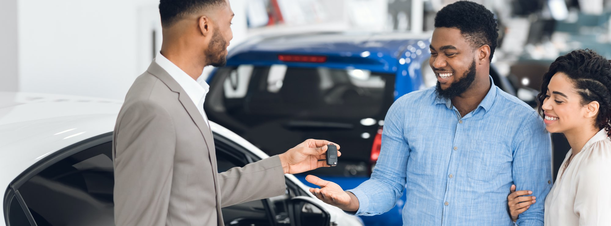 man and woman buying new car